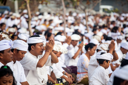 performed: BALI, Indonesia - MAR 9, 2013: Local people during performed Melasti Ritual. Melasti is a Hindu Balinese purification ceremony and ritual is held several days prior to the Nyepi holy day. Editorial