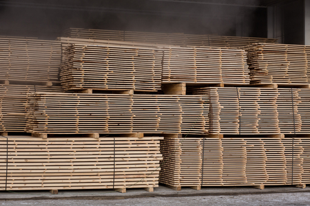 Edging board in stacks in the dryer. Stock Photo