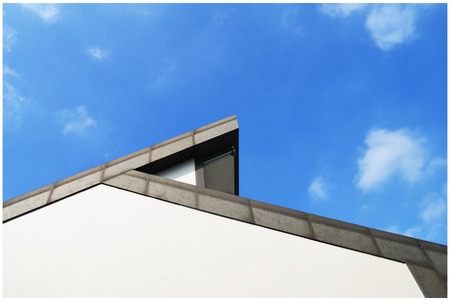 Close up view of the roof and wall under the blue sky Reklamní fotografie