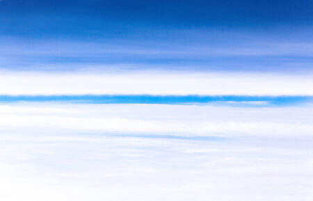 Boundary zone between a sea of clouds and the upper cloudy sky photo