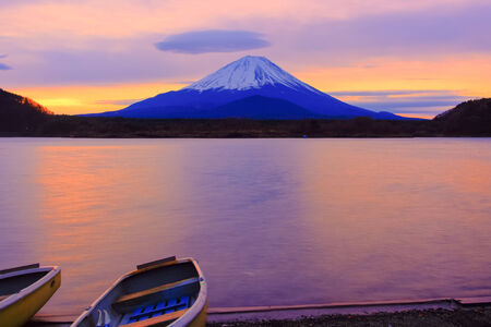 Mount Fuji and boats at sunrise Lake Shoji-ko photo