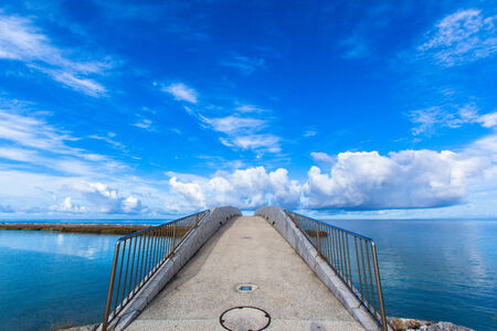 parapet: Arched bridge over the sea Stock Photo