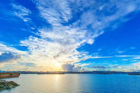 Morning sky of Okinawa harbor Stock Photo