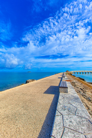 breakwater: Breakwater road with benches Stock Photo