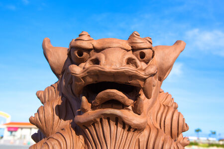 Brown Shisa monument in Okinawa
