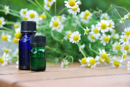 aromatherapy oils: essential oils with chamomile Stock Photo