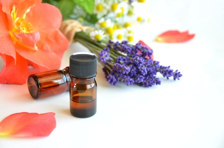 essential oils for aromatherapy treatment with herbal flowers