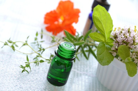 essential oils for aromatherapy treatment with herbs photo