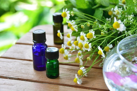 essential oils with herbal flowers photo