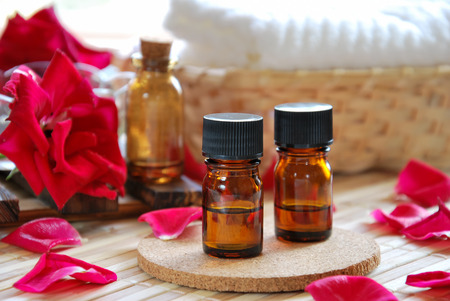 essential oils with roses for aromatherapy treatment