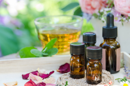 essential oils with herbs for aromatherapy treatment