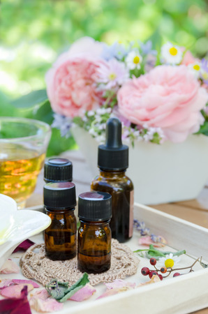 essential oils with roses and herbs for aromatherapy treatment Zdjęcie Seryjne