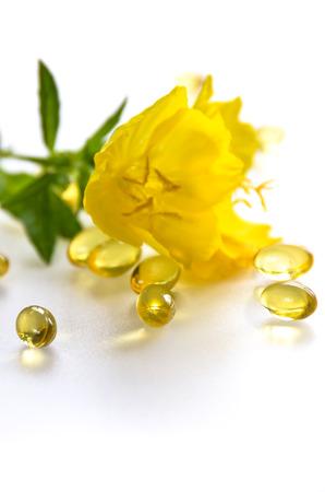 supplement and evening primrose flower Foto de archivo