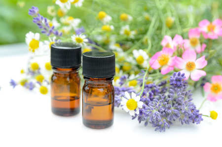 essential oils: essential oils with herbal flowers Stock Photo