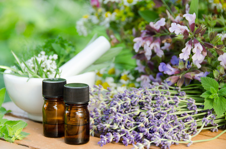 essential oils with herbal flowers for natural therapy