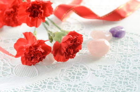 gemstones: red carnation flowers and gemstones