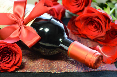 red wine bottle with roses