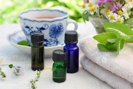 essential oils with tea in garden spa salon Standard-Bild