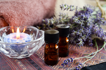 essential oils with lavender in candle light