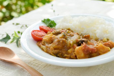 vegetable curry: vegetable curry at garden table Stock Photo