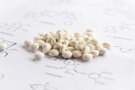white pills on science sheet