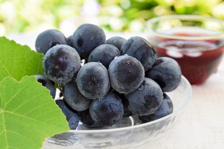 grape and juice in garden Standard-Bild