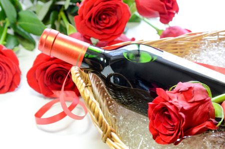 wine and roses in white background Standard-Bild