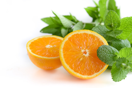 orange and mint leaves in white background