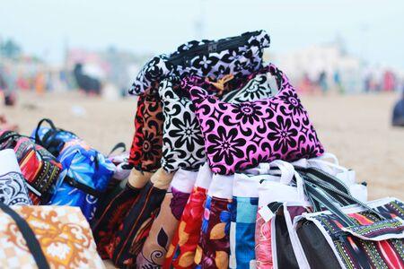 colorful bag at sea beach for sale Фото со стока