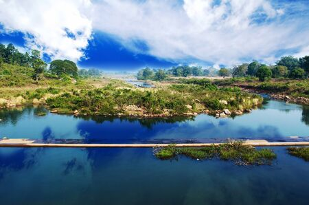 wide angle of a river with cloud sky
