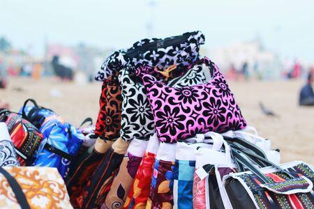 heap of colorful bags at sea beach