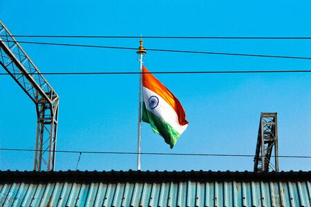 Indian flag near railway station and railway electric wire at platform