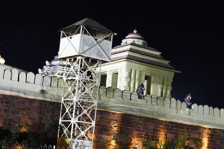 Sri jagannath temple boundry wall at night with colorful yellow lights and security check post dated 21 february 2020 Puri Odisha India Фото со стока