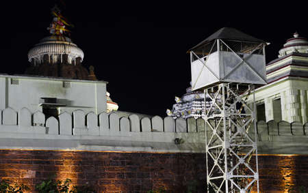 Sri jagannath temple boundry wall at night with colorful yellow lights and security check post dated 21 february 2020 Puri Odisha India Редакционное