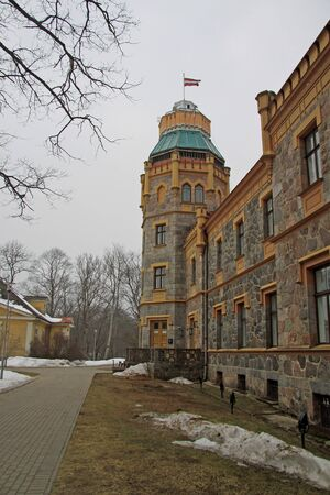 sigulda: SIGULDA, LATVIA - MARCH 17, 2012: Sigulda Town Council located in 19-th century castle. Sigulda castle was built in 1878. Editorial