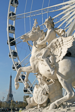 concorde: Statue of King of Fame riding Pegasus on the Place de la Concorde with ferris wheel at background, Paris, France Editorial