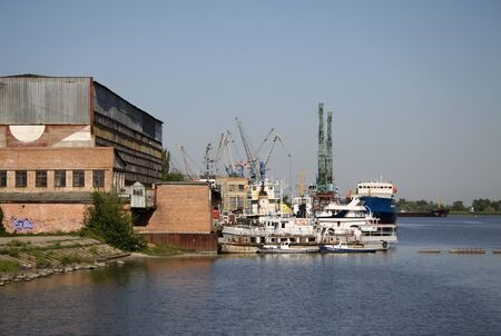 shipbuilding: AZOV, RUSSIA - AUGUST 28, 2011: Shpyard of shipbuilding and repairing company Azov Shipyard CJSC on the river Don Editorial