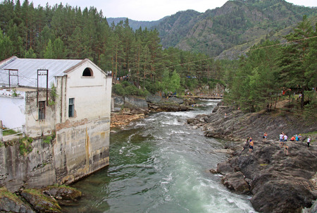 chemal: SIBERIA, RUSSIA - JUNE 11, 2012: The old hydroelectric power station on the river Chemal in Altai mountains in Russia