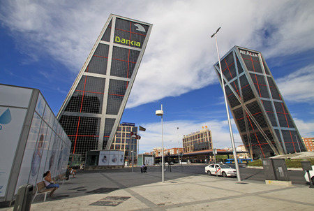 castellana: MADRID, SPAIN - AUGUST 25, 2012: The Gate of Europe Puerta de Europa towers also known as KIO Towers on Paseo de la Castellana in Madrid