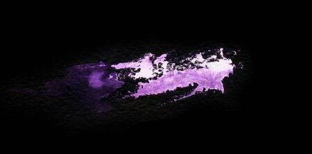Grunge violet splash isolated on a black background. Texture shape for design. Abstract art drawing. Handwork