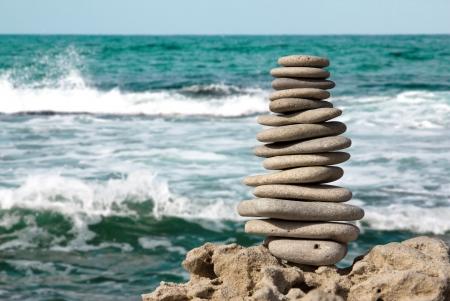 Staked stones on sea background macro closeup Фото со стока