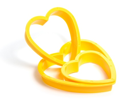 Yellow plastic cookies cutter isolated on white photo