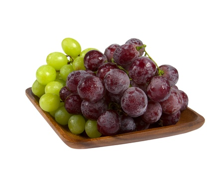 Bunches of black and green grapes isolated on white background