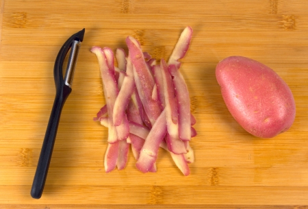 process of cooking french fries on wooden board