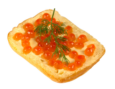 Sandwich with red caviar a sprig of dill on white background