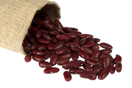 Red beans in a bag isolated on white closeup shot