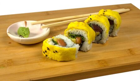 Sushi with tuna and scrambled eggs Фото со стока