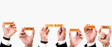 Learn & lead concept. wooden blocks in hand with inscriptions Competence, skill, Learning, experience, Leadership Archivio Fotografico