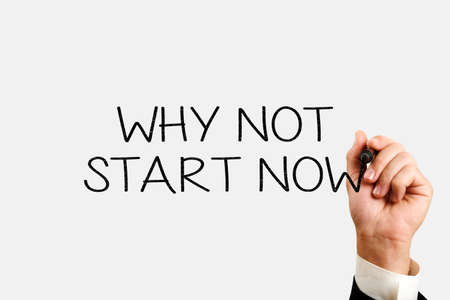 why not start now concept. male hand writes why not start now