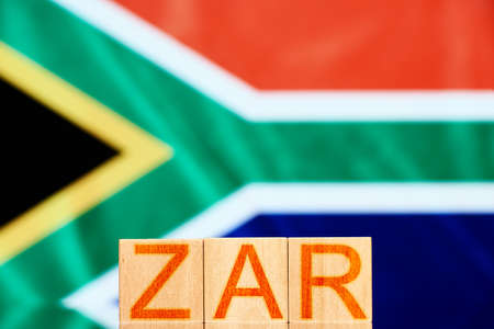zar. wooden blocks with zar lettering on south africa flag background